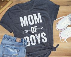 MOM OF BOYS | Relaxed modern boyfriend style tee for women  This modern tee is in a relaxed fit, super flattering and fits true to size. Its a boyfriend style unisex tee, styled here with the sleeves rolled. If you want a smaller fit, you may prefer to size down. You can roll the sleeves and throw on your favorite pair of denim shorts & youre ready to go chase your little ones around. :)  Any questions on sizing, please message me!  52% combed and ring-spun cotton, 48% poly, incredibly soft…