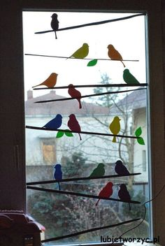 The decoration, which can be seen in the pictures, shows a flock of birds sitting - New Deko Sites Decoration Creche, Class Decoration, School Decorations, Spring Decorations, Bird Crafts, Easter Crafts, Diy Crafts For Kids, Home Crafts, Window Art