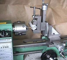 Milling Attachment by Varmint Al -- Homemade milling attachment for a lathe, constructed from an angle plate and a drill vise. http://www.homemadetools.net/homemade-milling-attachment