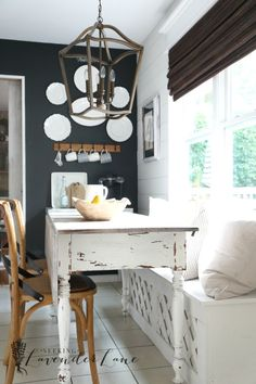 Farmhouse Tour Friday   Rooms FOR Rent Blog- dark wall, white plates in kitchen