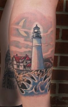 Lighthouse tattoo by John Garancheski III - This lighthouse tattoo was done from a photo of the lighthouse located in Maine.