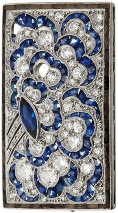 An Art Deco platinum, diamond and sapphire brooch, circa 1920. 3.5 x 2.5cm. #ArtDeco #brooch