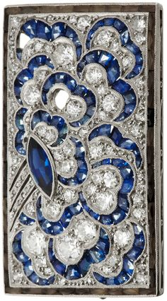 An Art Deco platinum, diamond and sapphire brooch, circa 1920. 3.5 x 2.5cm. #ArtDeco #brooch