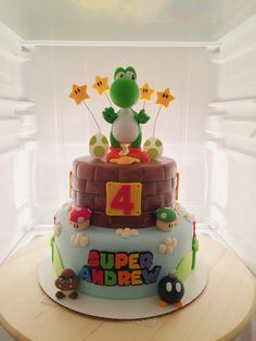 Birthday Cakes Glasgow City Centre Yoshi Super Mario Theme Birthday Cake Yoshi Toy Purchased From Mario Bros Cake, Super Mario Cake, Super Mario Party, Mario Birthday Cake, Super Mario Birthday, 5th Birthday, Mario Yoshi, Drunk Barbie Cake, Nintendo Cake