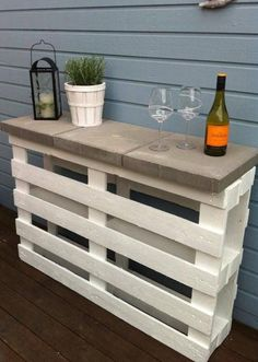 Nail two pallets together paint and add a few garden pave stones