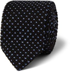 A confident sartorial choice, a knitted tie can unlock several dress codes - both for casual occasions and the office - and thus every man should own at least one. In classic black and blue, this Berluti piece can be dressed up when paired with sharp tailoring or down when worn with chinos and a cardigan.