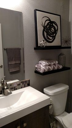 Small bathroom remodel, grey tones, great decor from Hobby Lobby.