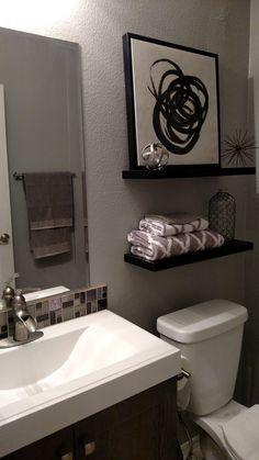 Small bathroom remodel, grey tones, great decor from Hobby Lobby.