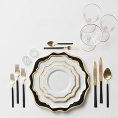Anna Weatherley Chargers in Black/Gold + AW Dinnerware + NEW two-toned Axel Flatware in 24k Gold/Matte Black finish + Gold Rimmed Stemware + Antique Crystal Salt Cellars | Casa de Perrin Design Presentation