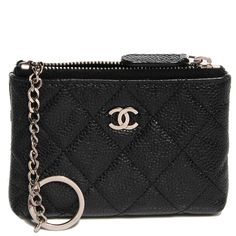 This is an authentic CHANEL Caviar Key Holder Case in Black.  This ultra-stylish key case is crafted of luxurious diamond quilted Chanel signature caviar leather.  The case features a top zipper that opens to a fabric interior with room enough for keys, currency, accessories or cosmetics, it is ideal for your must have necessities with the timeless style only from Chanel!