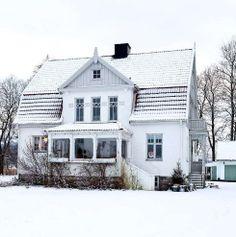 scandinavian house in snow