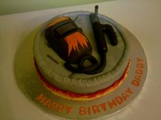 Welders Cake - Welding helmet and lead made of RK treats. The cake covered with buttercream frosting.