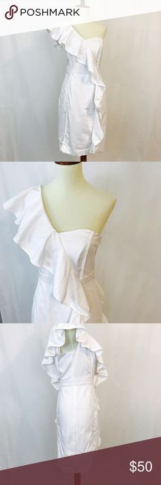 """Vince Camuto white cotton ruffle dress EUC Has cascading ruffles on front and back. Figure flattering silhouette in soft slightly stretchy cotton with side zipper closure. 17"""" UA to UA 34"""" length Vince Camuto Dresses"""