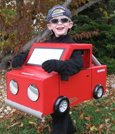 Cardboard truck costume! :)  M wants to be a tow truck this year.
