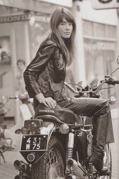 Françoise Hardy on the back of a Honda bike