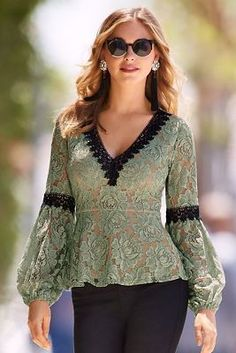 V-neck Lace Top Boston Proper fashions~ A black embroidered v neckline and arm bands add color contrast to our figure-flattering peplum knit top cut from feminine lace with long sheer bell sleeves and elastic cuffs. Kurta Designs, Blouse Designs, Blouse Dress, Lace Dress, Lace Peplum, Sleeves Designs For Dresses, Hijab Stile, Blouse Styles, Lace Tops