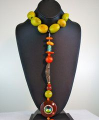 Taua shells, bronze beads and large carnelian stone makes this Statement necklace Irresistible.  Pin this necklace to your board. http://www.myfabpins.com/collections/necklaces/products/babeena-statement-necklace
