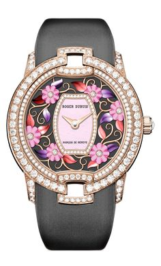Blossom Velvet | RDDBVE0056 | Roger Dubuis | Firmly yet softly embracing the curves of the feminine wrist, the shimmering satinfinish fabric strap – in a blushing pink or cerulean blue matching the dial – provides a perfectly smooth, lustrous backdrop for the 154 diamonds.