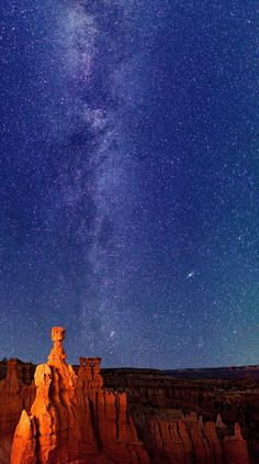 A photograph of Thor's Hammer at Bryce Canyon National Park on September 20, 2011 in Utah with the Milky Way overhead