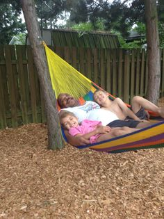 Babies and grandpa in the hammock