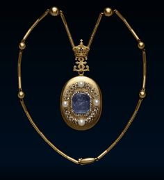 Empress Eugénie's Locket, Circa 1860. Gold oval locket, set with a sapphire cameo of a Muse with lyre, framed in diamonds, within a diamond and pearl laurel wreath. Inside is a glazed compartment with a photograph of the Empress. The locket is attached by a gold double E cipher surmounted by the Napoleonic Imperial crown. This historic locket was a gift from the Empress to Lady Burgoyne in thanks for enabling her to flee France for England on her yacht after the fall of the Second Empire.
