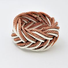 A knot ring, woven with fine silver and copper wire.. $145.00, via Etsy.