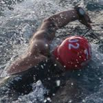 Some triathletes can't decide if their stroke should be long or short. Clear up the confusion and become a more efficient swimmer with these five drills.