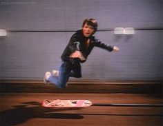 Michael J Fox as Marty Mcfly in Back to the Future (Behind the Scenes & hovering over the hoverboard) Marty Mcfly, Michael J Fox, Emmett Brown, The Future Movie, Back To The Future, Science Fiction, Childhood Ruined, Bttf, Funny Couples