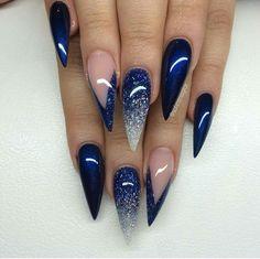 Blue glittery stiletto nails