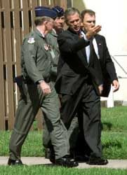 President Bush, accompanied by Lt. General Thomas Keck, September 11, 2001.  picture: Historycommons.org