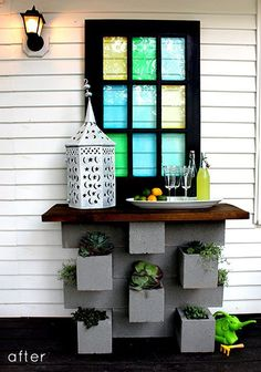 A planter/serving table made from cinder-blocks. Someone finally found an attractive purpose for these items. Very cool.