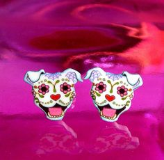 Dia de los Muertos Sugar Skull Pit Bull Post Earrings   2 dollars from each pair will go to Villalobos Rescue Center. $ 12.95, via Etsy.