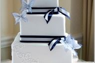 A CLASSIC NAVY AND WHITE WEDDING CAKE WITH BUTTERFLIES.. Maybe without the butterflies