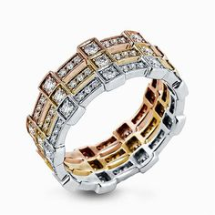This trio of yellow, rose, and white gold bands form a modern style band set with 1.05 ctw of striking round cut white diamond accents. Print Page
