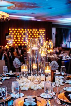 Glamorous centerpieces added drama to the wedding reception. How beautiful!? {Nadia D Photo}