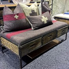sheridan0 Uber Chic Home's vintage Swiss Army blankets repurposed as pillows and fabric for a bench cover. The bench is made of metal and old California grape harvest crates. (scheduled via http://www.tailwindapp.com?utm_source=pinterest&utm_medium=twpin&utm_content=post29913146&utm_campaign=scheduler_attribution)