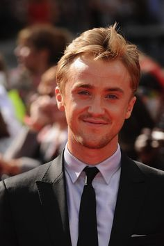 Actor Tom Felton attends the World Premiere of Harry Potter and The Deathly…