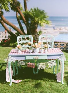 hand painted sweetheart table http://www.weddingchicks.com/2013/12/20/mint-and-peach-wedding/