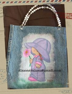 Bolsa hecha con parte de un pantalon de mezclilla y pintada a mano