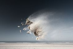 """""""Airborne clumps of beach sand air form animal-like shapes in the photo series """"Sand Creatures"""" by photographer Claire Droppert. The series is the first installment of """"Gravity,"""" Droppert's photo project of natural elements depicted in moments of weightlessness."""""""