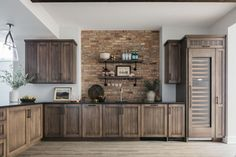 I love the cabinet stain color along with the reclaimed brick backsplash What a perfect combo #cabinet #maplecabinet #cabinetcolor #brickbacksplash