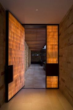 Designed by architect Dick Clark and constructed by Gary McFarland, this artistic door glows brightly from within thanks to the ethereal lights sandwiched between semi-transparent onyx panels.