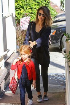 This way little girl: The Fantastic Four star steered the tot along the right path...