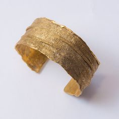 A 14k gold cuff with the look and feel of textile. Wow, wow, wow.