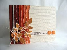 fall colors.  Love the layered torn paper idea
