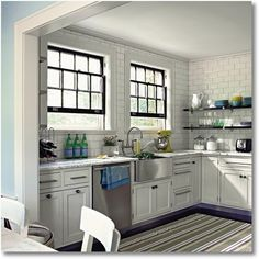 Black windows in white kitchen - I love the way it adds subtle contrast and makes the windows really pop. Also: green?