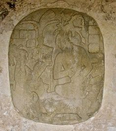 """The crowning of K'inich Janaab Pakal (Pakal the Great). Pakal, whose name means """"Sun Shield,"""" was the greatest ruler of Palenque. Above, you can see Pakal on the right being presented with his crownining head dress by his mother on the left.She had been Regent during his early life.This oval relief carving,now badly worn,can be found in the Palace,the center of power.Pakal lived an extremely long life for his time,from march 26,603AD to march 31,683 S,and actually ruled for 68 years."""