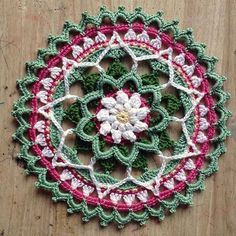 Spring Daisy Mandala - gorgeous free crochet pattern at The Crafty Cowrie.
