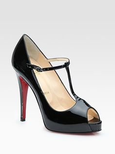 Christian Louboutin peep toe pumps.  I lust after these shoes and I love the t-strap detail.