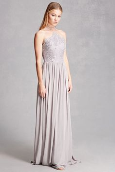 A woven maxi dress featuring a halter neckline, a sequined and embroidered bodice, adjustable cami straps, a concealed zipper back, a sleeveless cut, and a textured skirt. This is an independent brand and not a Forever 21 branded item.